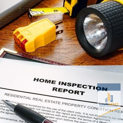 A Home Inspection Report on a Desk With Flashlight.